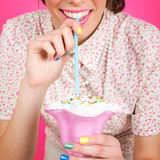 Vintage pin-up young woman with milk shake Royalty Free Stock Image