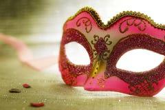 Vintage pink carnival mask. Vintage pink venetian carnival mask Stock Photo