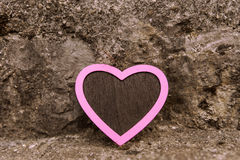 Vintage pink heart in front of a stony background Stock Photos