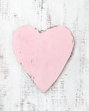 Vintage pink heart on a wooden background