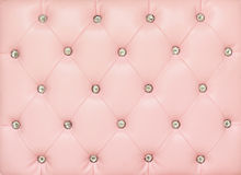 Vintage pink leather background. With crystal button stock image