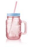 Vintage pink mason jar mug with lid and straw Royalty Free Stock Images