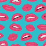 Vintage pink red lips kiss seamless pattern on blue background. Stock Photo