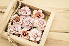 Vintage pink rose and Pearl Necklace. Royalty Free Stock Image