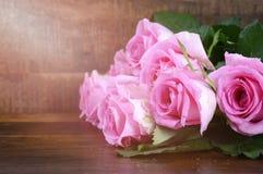 Vintage Pink Roses on Dark Wood Background. Royalty Free Stock Photos