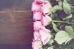 Vintage Pink Roses on Dark Wood Background. Royalty Free Stock Image