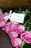 Vintage Pink Roses on Dark Wood Background. Royalty Free Stock Photo