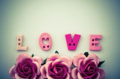 Vintage pink roses flower and love text. Stock Photos