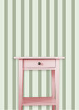 Vintage pink wooden chest drawer near vintage dots wall Royalty Free Stock Photos