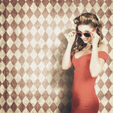 Vintage pinup fashion model in womens sunglasses Stock Photos