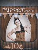 Vintage pinup girl inside a puppet show booth Royalty Free Stock Images