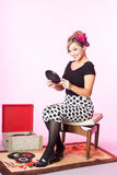 Vintage pinup style of cute blond with vinyl records Royalty Free Stock Photos