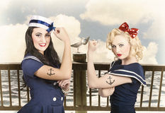 Vintage pinup style. Two retro sailor pinup girls Stock Photography