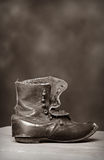 Vintage Pioneer Child Shoe. In Black and White Hight Contrast royalty free stock photo
