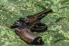 Vintage pistol on pixel camouflage background Stock Photos