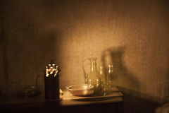 Vintage pitcher and glass. Still life with vintage pitcher and glass in the medieval alchemist room Stock Image