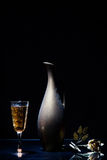 Vintage pitcher and a glass of wine Royalty Free Stock Photo