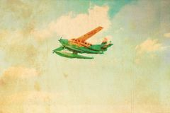 Old, stained paper background with plane on the sky Royalty Free Stock Photo