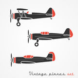Vintage planes set. Set of three retro planes; gray silhouettes on white background Stock Photo