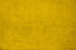 Vintage plaster yellow painted wall background Stock Photography