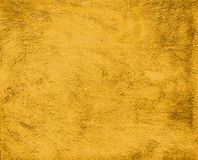 Vintage plaster yellow painted wall background Royalty Free Stock Photos