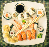 Vintage Plate of Sushi. Upper view of a vintage plate of Sushi ready to be tasted Stock Image
