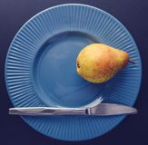 Vintage plating decoration - yellow pear. Vintage plating. simple : knife + yellow pear. Nostalgia theme Stock Images