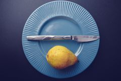 Vintage plating decoration - yellow pear. Vintage plating. simple : knife + green pear. Nostalgia theme Stock Photo