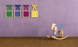 Vintage play room with wooden horse Stock Image