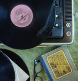 The vintage player of vinyl records. Retro toning Stock Photography