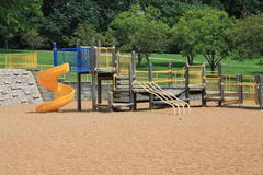 Vintage playground with yellow slide Royalty Free Stock Photos