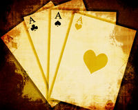 Vintage playing cards. On a grunge background Stock Photography