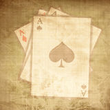 Vintage playing cards. On a paper background with soft scratches Stock Photography