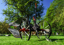 Vintage plough on a grass Royalty Free Stock Images