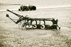 Vintage Plow in a Farm Field Stock Photo