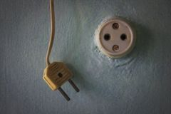 Old power socket and plug on painted wall Royalty Free Stock Photo