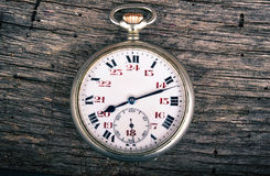 Vintage pocked watch on wood Royalty Free Stock Image
