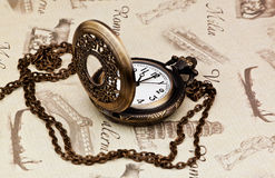 Vintage pocket watch. On a old map Stock Photos