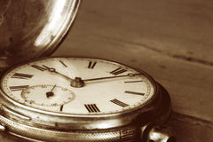 Vintage Pocket Watch. Over old timber. Sepia tone, lots of dust stock photography