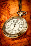 Vintage pocket watch. Vintage Antique pocket watch on an ancient world map in 1565 Stock Photo