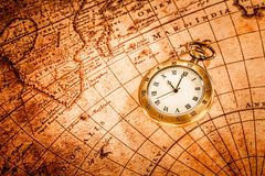 Vintage pocket watch. Vintage Antique pocket watch on an ancient world map in 1565 Royalty Free Stock Photo