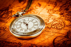 Vintage pocket watch. Vintage Antique pocket watch on an ancient world map in 1565 Royalty Free Stock Photos