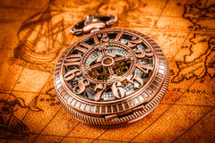 Vintage pocket watch. Vintage Antique pocket watch on an ancient world map in 1565 Stock Images