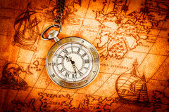 Vintage pocket watch. Vintage Antique pocket watch on an ancient world map in 1565 Royalty Free Stock Images