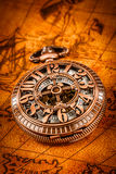 Vintage pocket watch. Vintage Antique pocket watch on an ancient world map in 1565 Stock Image