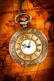 Vintage pocket watch. Vintage Antique pocket watch on an ancient world map in 1565 Stock Photos