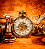 Vintage pocket watch. Vintage Antique pocket watch on an ancient world map in 1565 Stock Photography