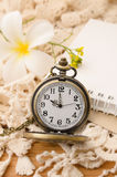 Vintage pocket watch with blank note book on lace background Royalty Free Stock Image