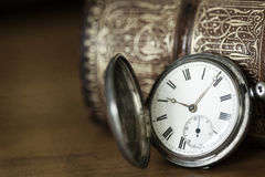 Vintage Pocket Watch and Book. Vintage pocket watch and old book, with grunge effects Royalty Free Stock Image