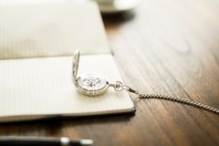 Vintage pocket watch on book Stock Photography